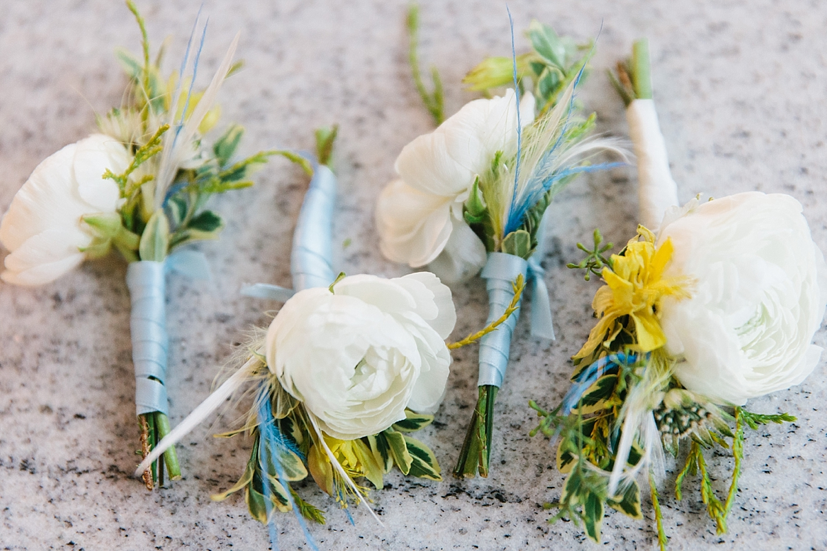 ranunculus boutonnieres with fishing flies