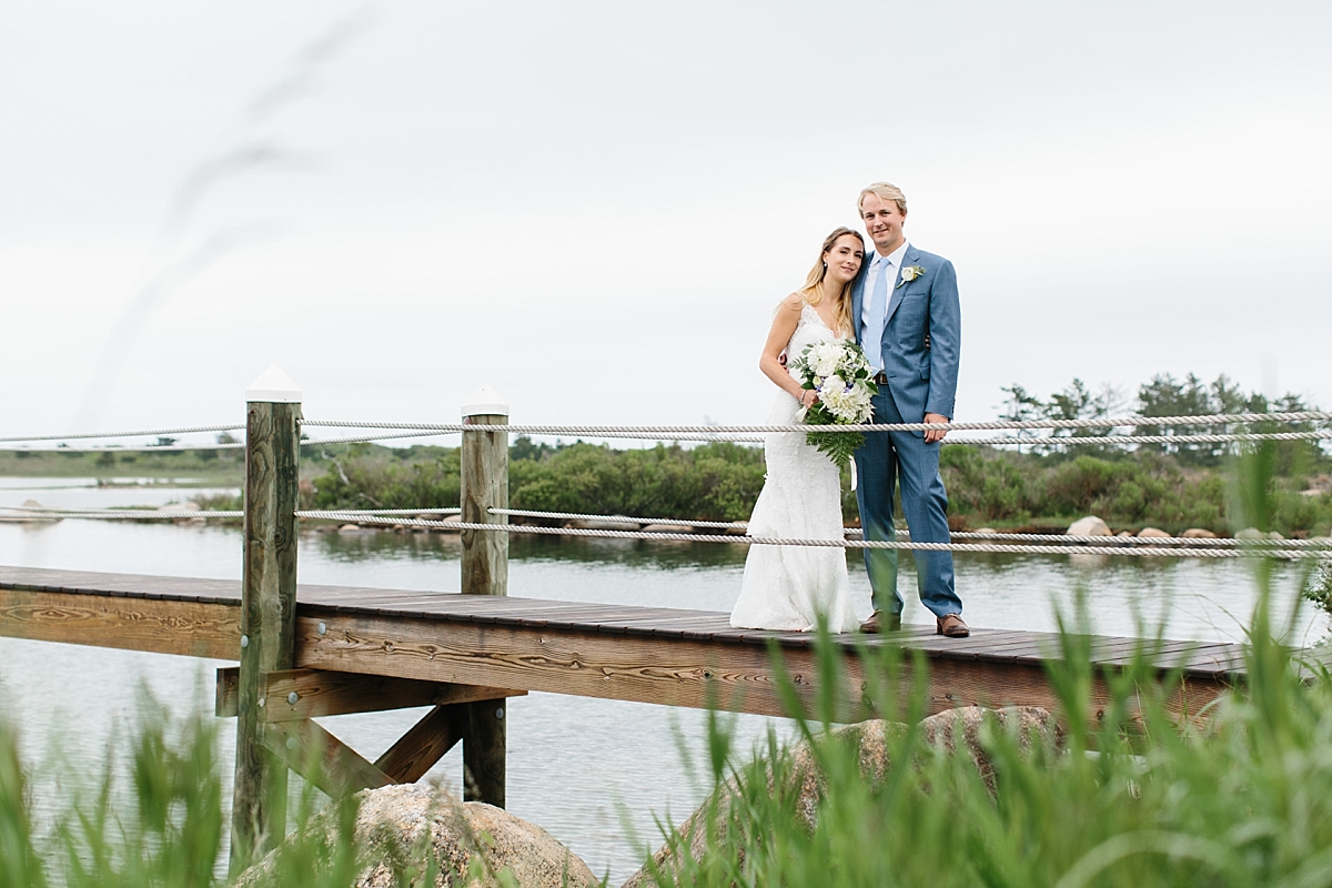 bride and groom on dock at weekapaug inn
