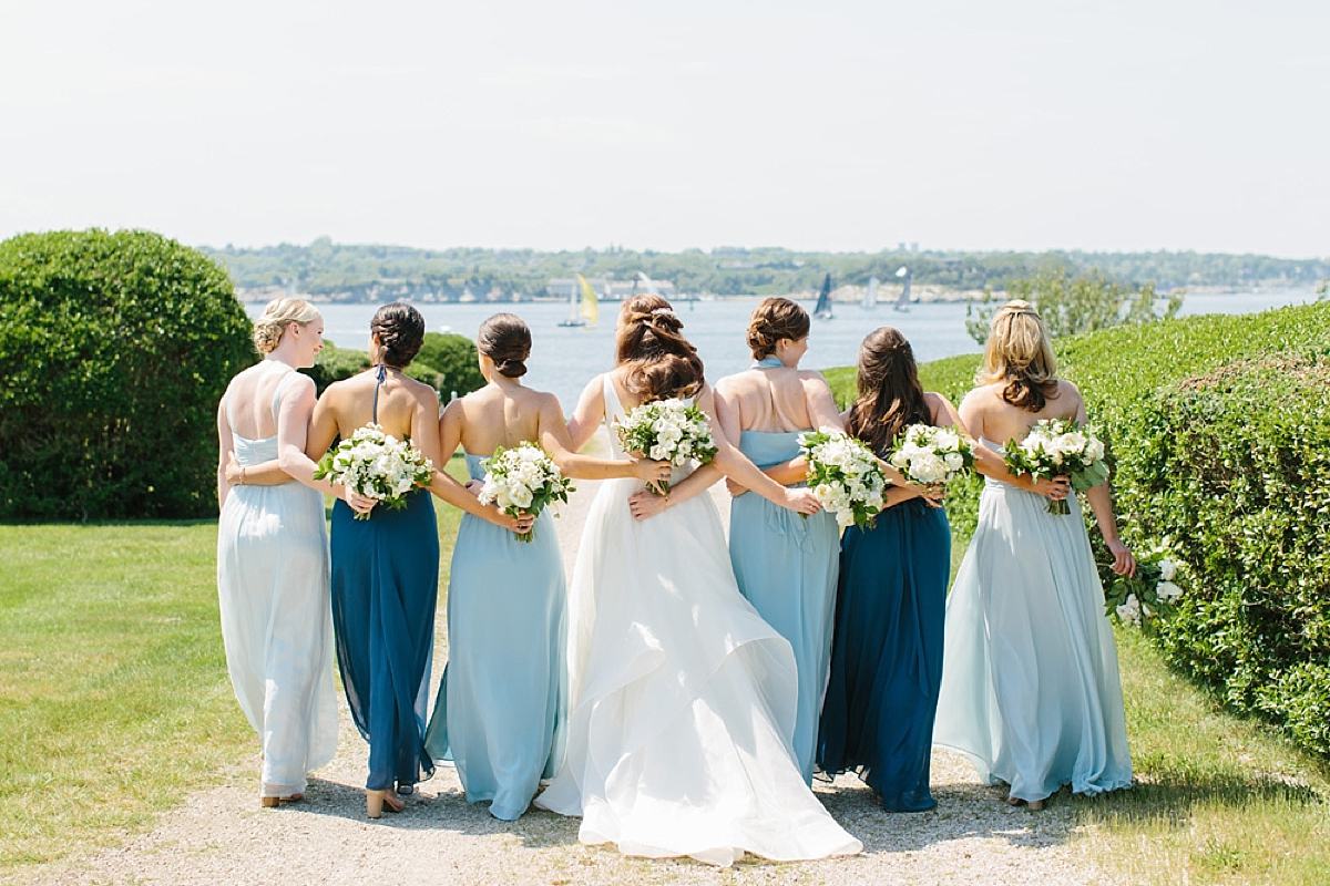 bridesmaids walking in blue dresses at eisenhower house
