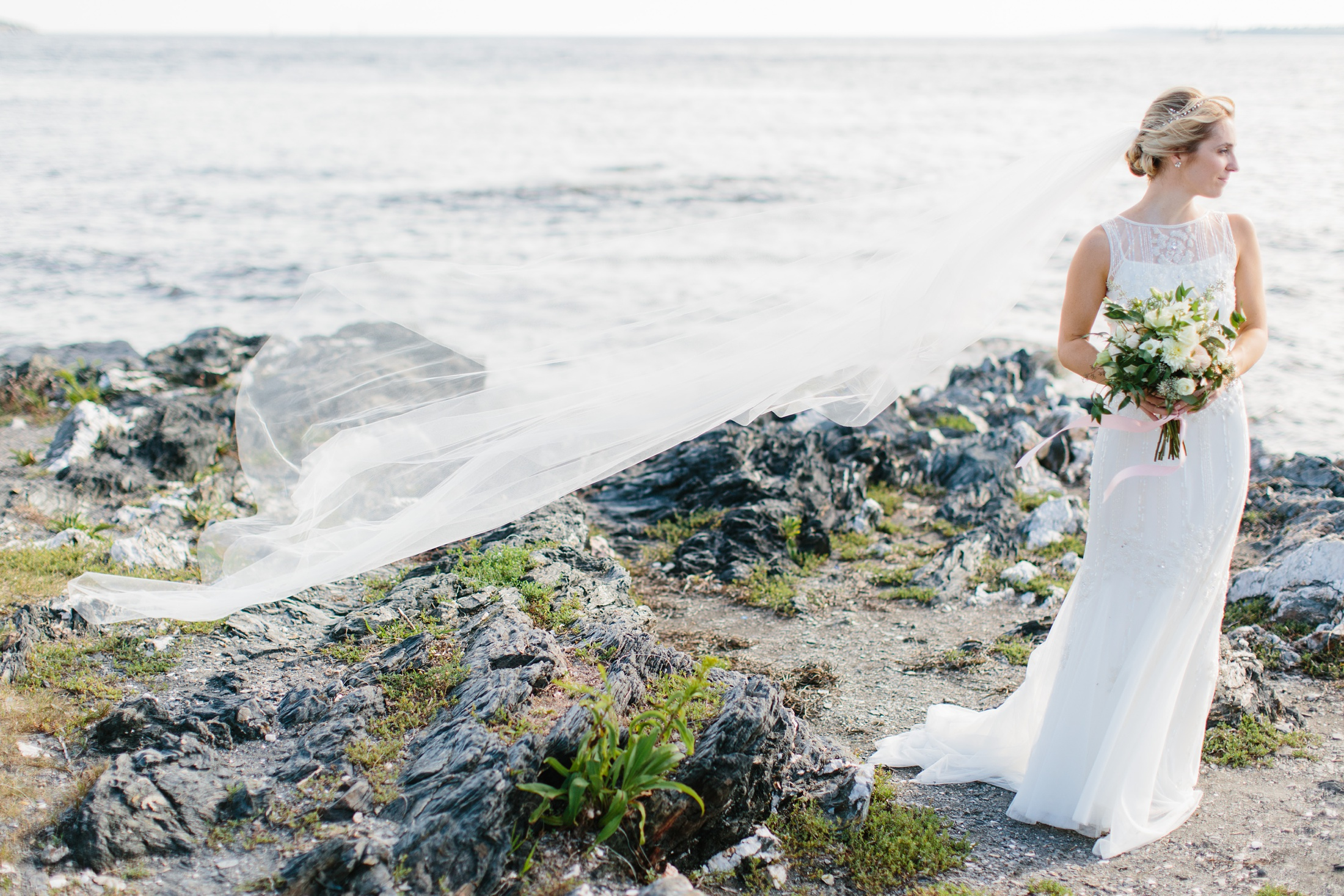 bride on rocks with veil blowing