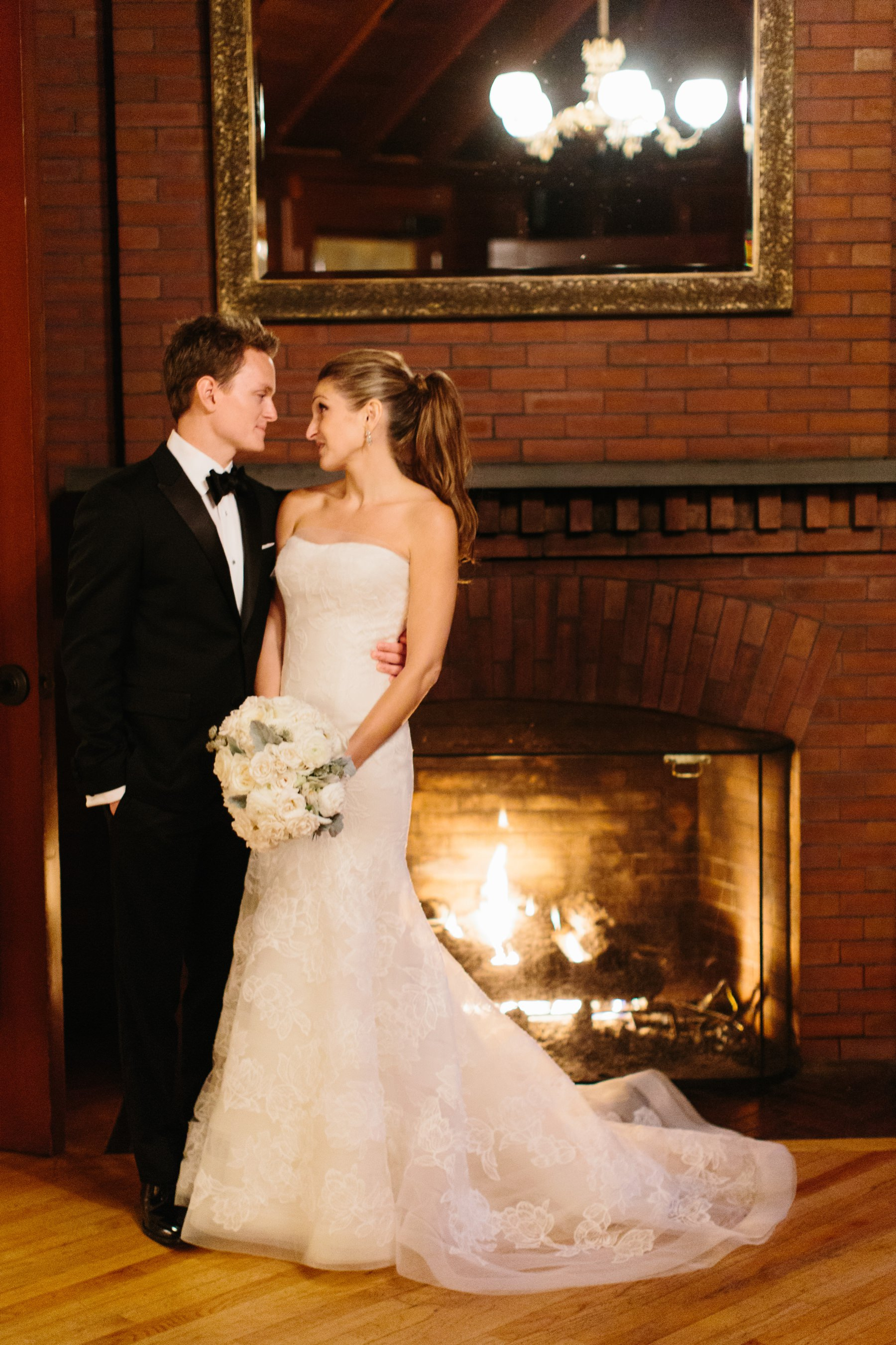 bride and groom near fireplace in chalet at castle hill