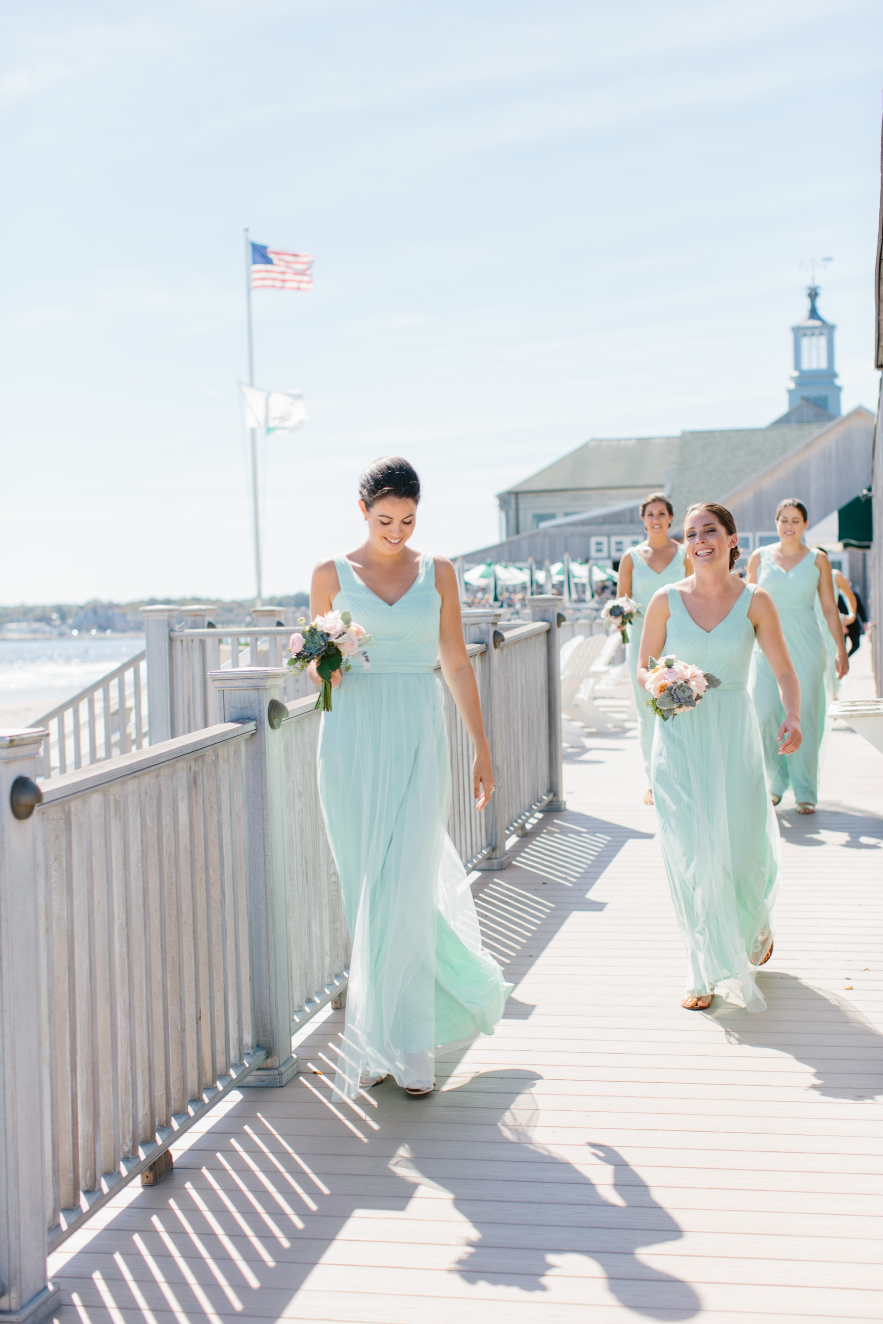 bridesmaids walking in aqua dresses