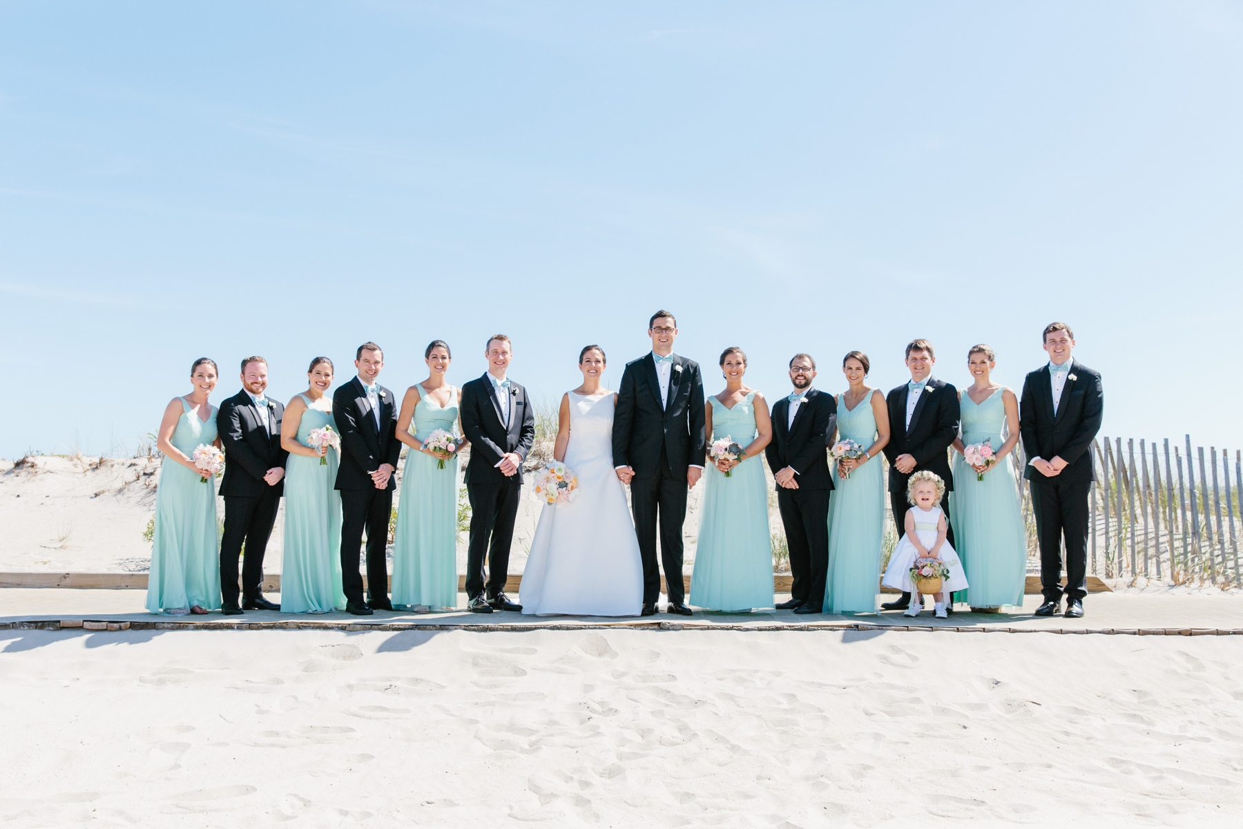 bridal party photo on narragansett beach