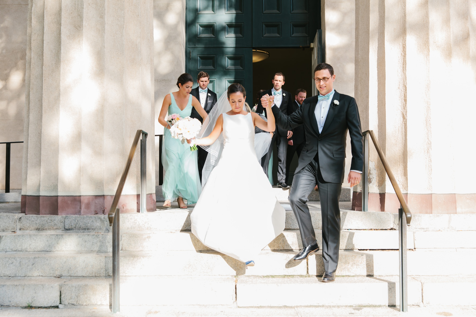 bride and groom exiting brown university chapel