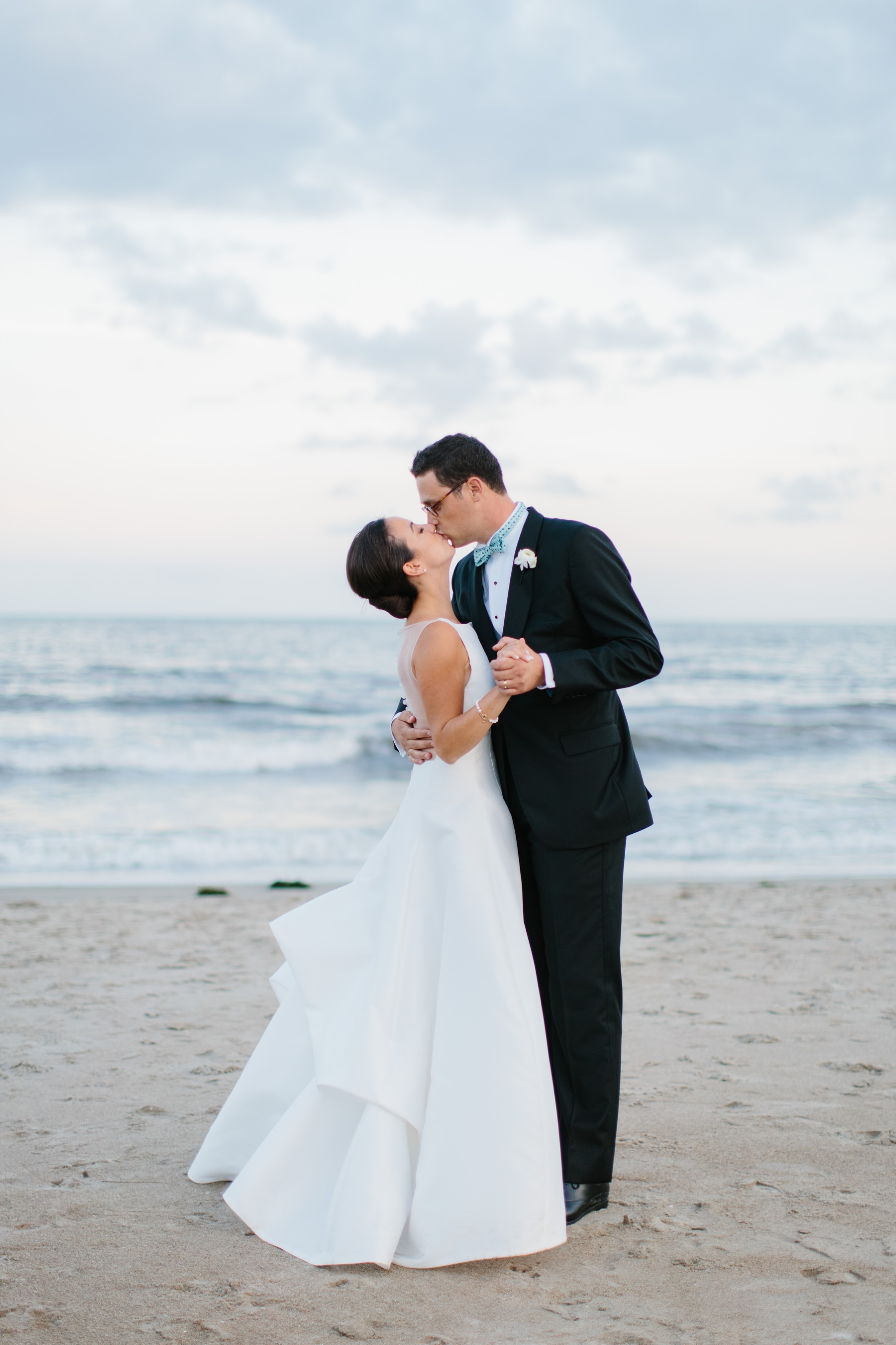 bride and groom at sunset on narrgansett beach