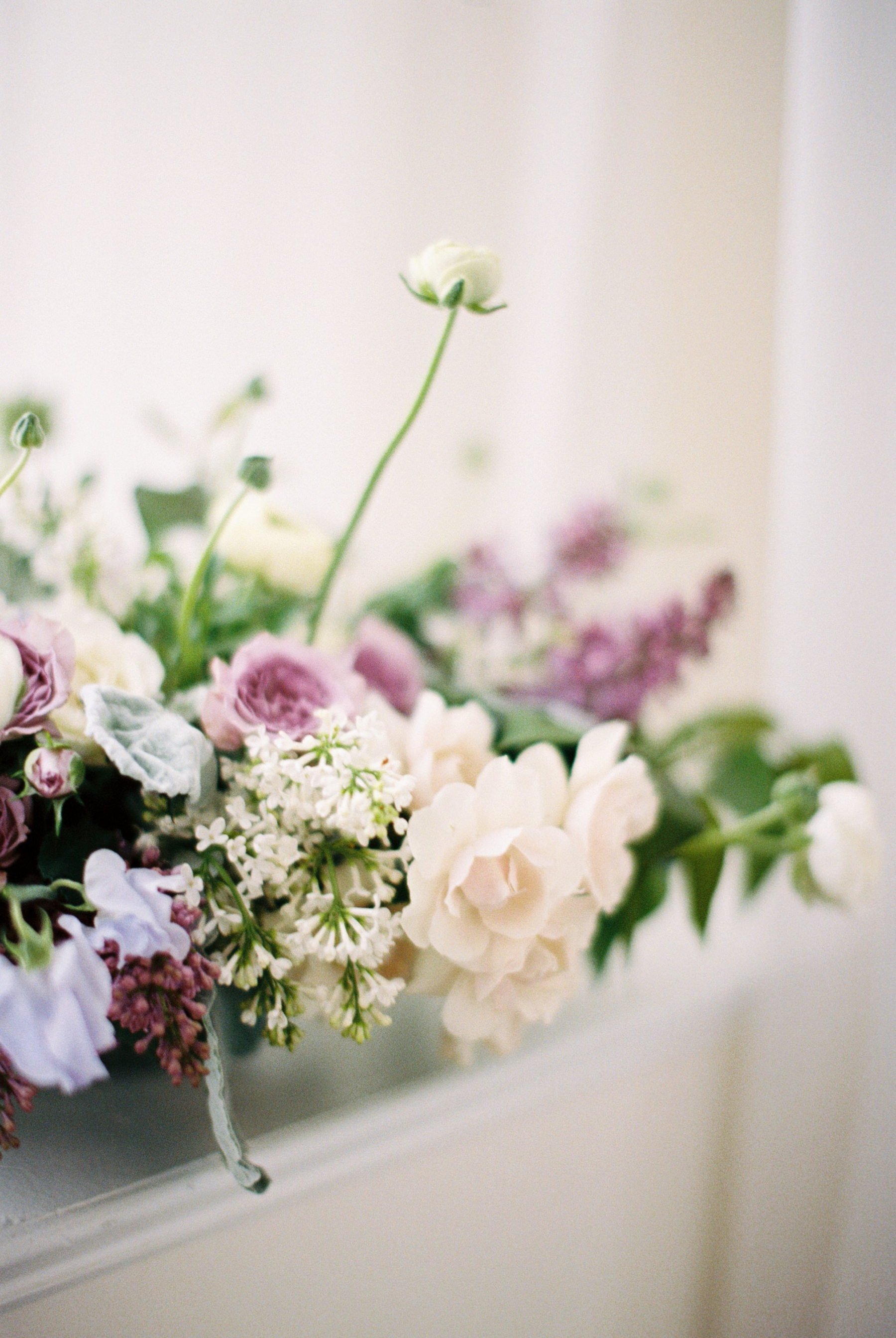 purple and lilac wedding flowers at belle mer