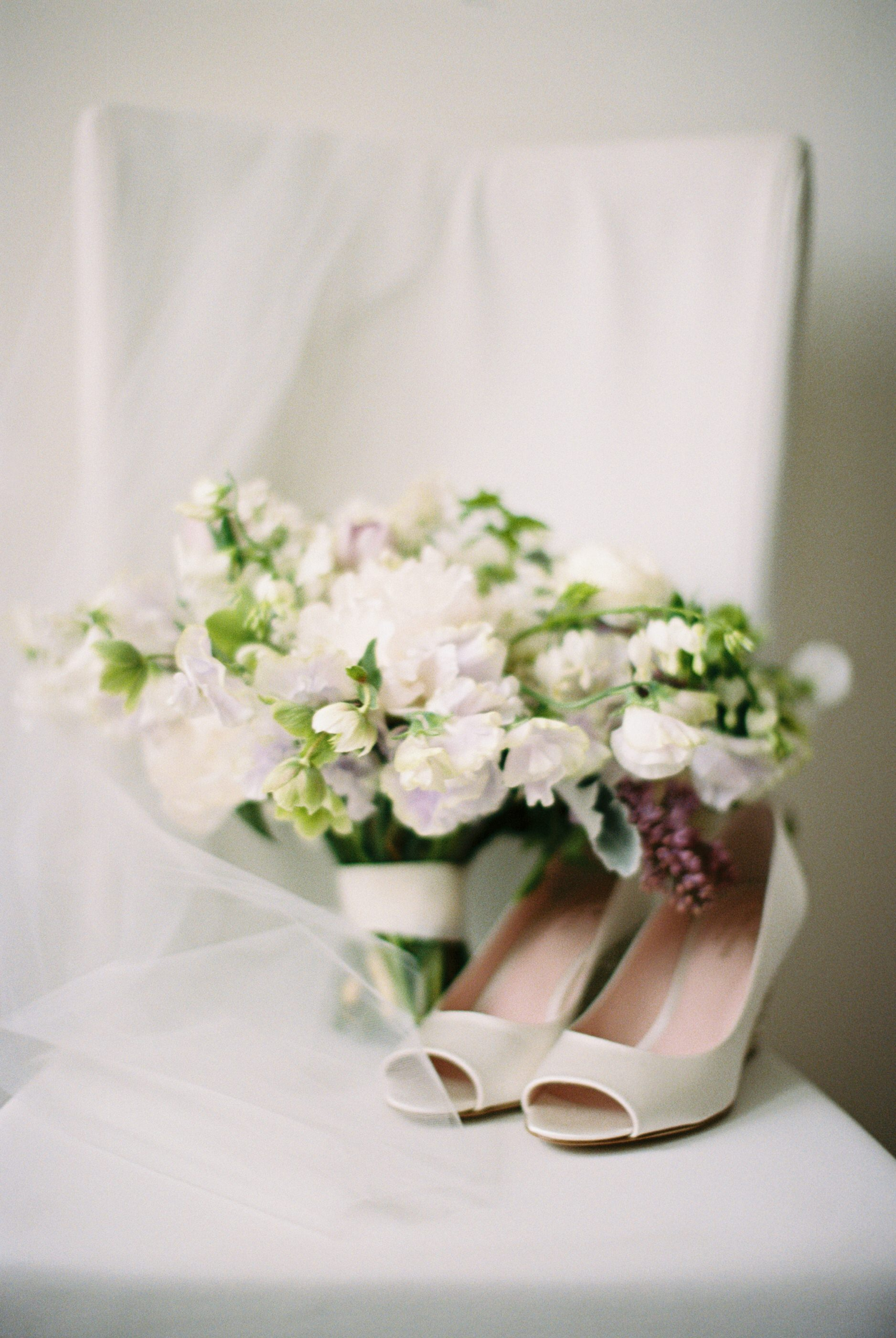 soft purple and white wedding bouquet with shoes