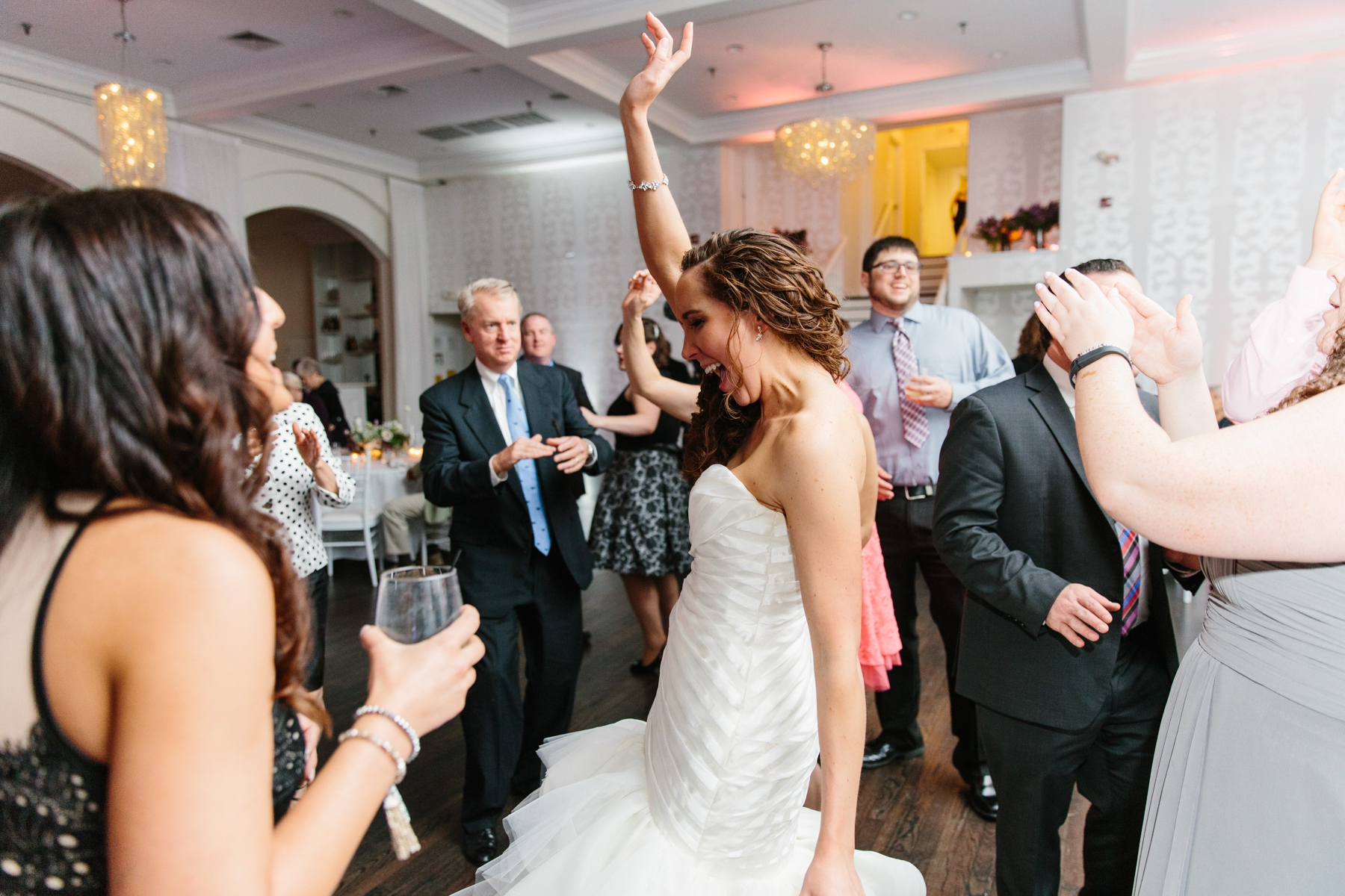 bride dancing in belle mer salon