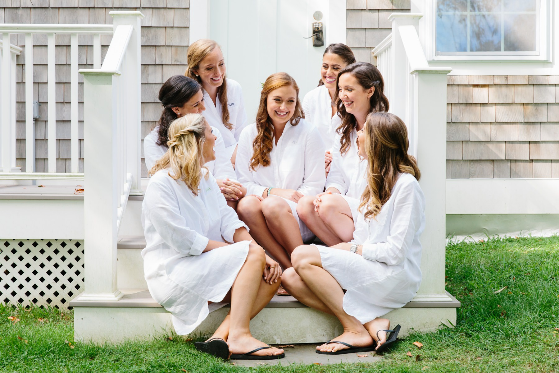 bridesmaids chat on porch