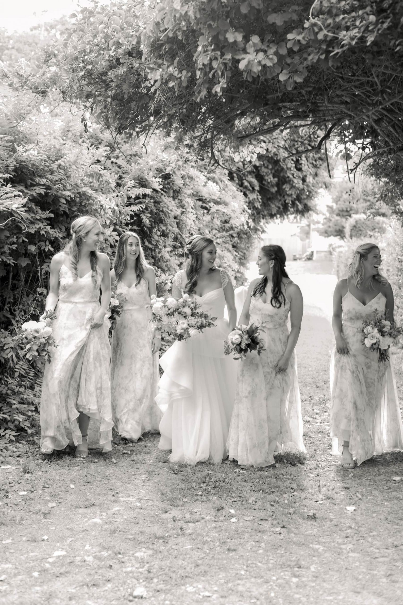 bridesmaids walking black and white