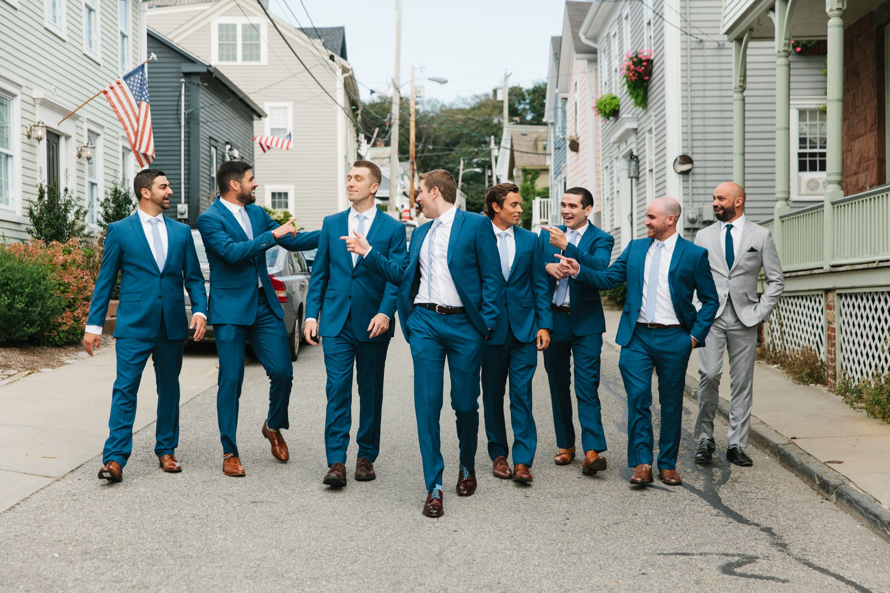groomsmen walk through downtown newport