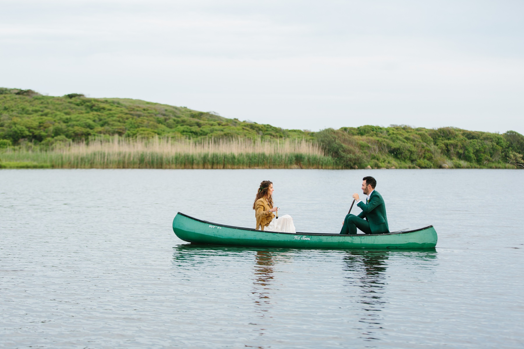 bride and groom in kayak at allen farm