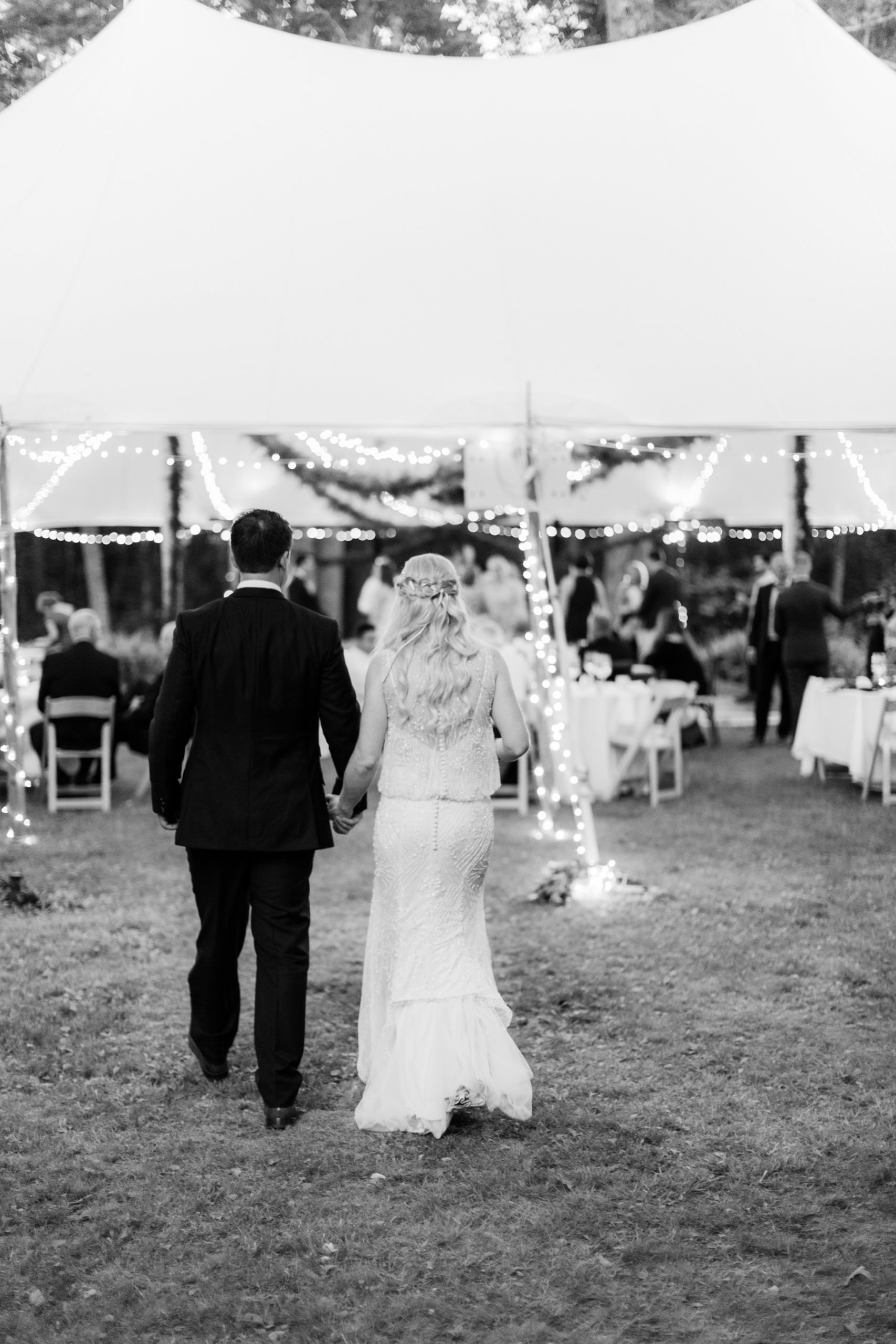 bride groom walk to tent